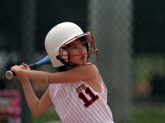Girl playing baseball